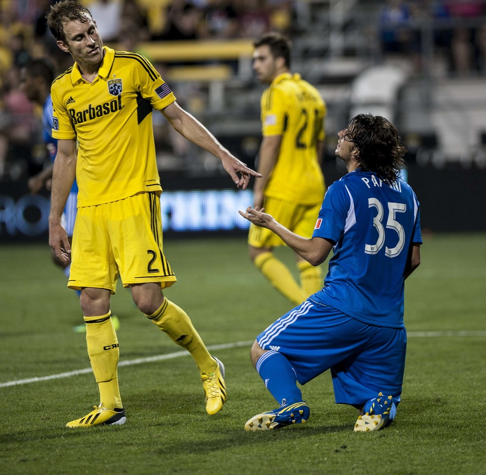 After a failed goal attempt by Montreal and at the final seconds of the game Columbus Crew's Joshua Williams gestures to Montreal Impact's Daniel Withrow on Saturday June 15th. The Columbus Crew won the game 2-0 against a devastated Montreal Impact.