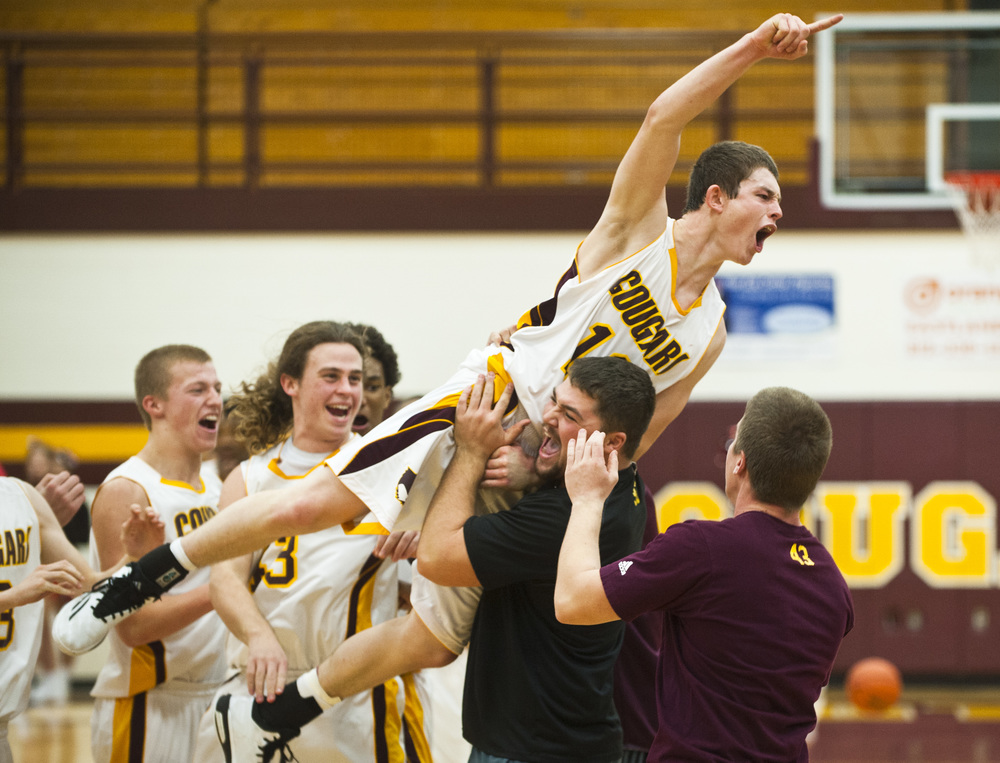 Bloomington North'sJacob Treadway shouts out in victory following the Cougar's triumph over Center Grove on Saturday, December 6 in Bloomington, Indiana.