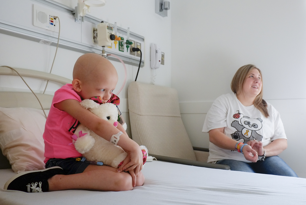 Alexes clutches a stuffed animal while she waits in-between treatments at Nationwide Children's Hospital in Columbus. Alexes' treatments lasted anywhere from a day to several days and she would have to have several treatments a month.