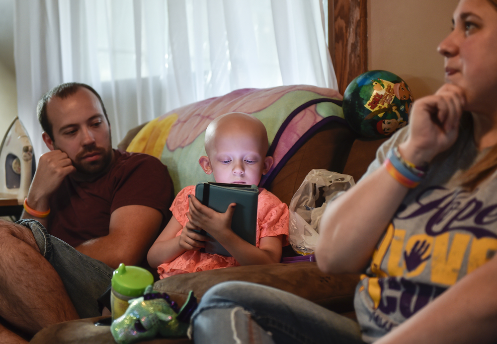 Lexi and her parents spend one of the days they don't have to go to children's hospital in Columbus relaxing at home. Throughout the ordeal Lexi spent her time reading on her iPad and watching television.