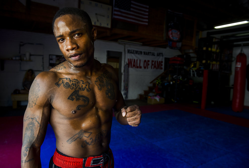 Bee Vanish, a mixed martial artist in Ohio, poses for a portrait at the gym he occasionally trains at: Maximum Martial Arts.