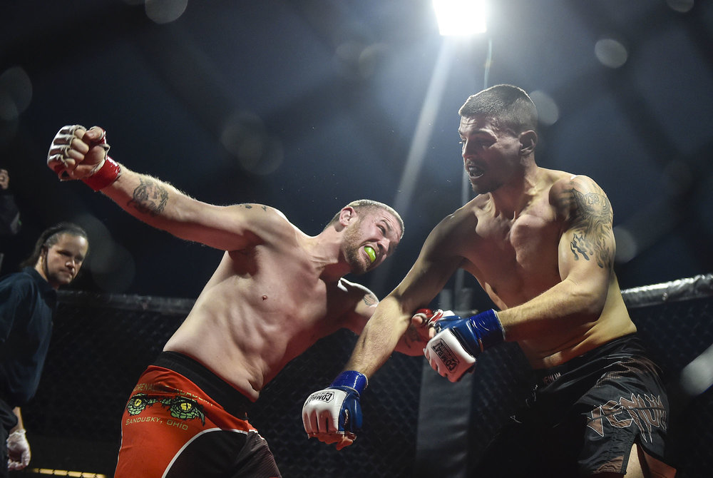 Terry 'The Pitbull' Demore throws a wild haymaker at his opponent Chris Fattig during their fight at Marion Mania III in Marion, Ohio. Fattig would go on to win the fight in the second round with a technical knockout victory over Demore.