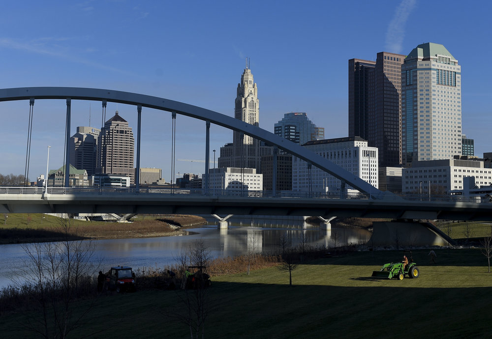 Workers start a days labor on the Scioto Mile in Downtown Columbus. The shores of the Scioto Mile, a project completed in 2015 by the city, feature native plants and a restored Scioto River with the removal of the dams that used to interrupt the flow over water through the downtown area. While the efforts to restore the river make some headway, there a many underlying issues facing the river that replanted native plants and dam removal won't fix.