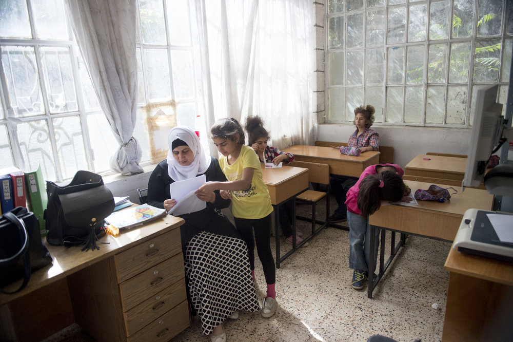 Ilham, a teacher at the Peace Center for the Blind checks the exam work of one of her students during exam week at the school. Following exam week the girls will move out of the boarding house they live in in East Jerusalem and return to their homes for the summer in the West Bank.