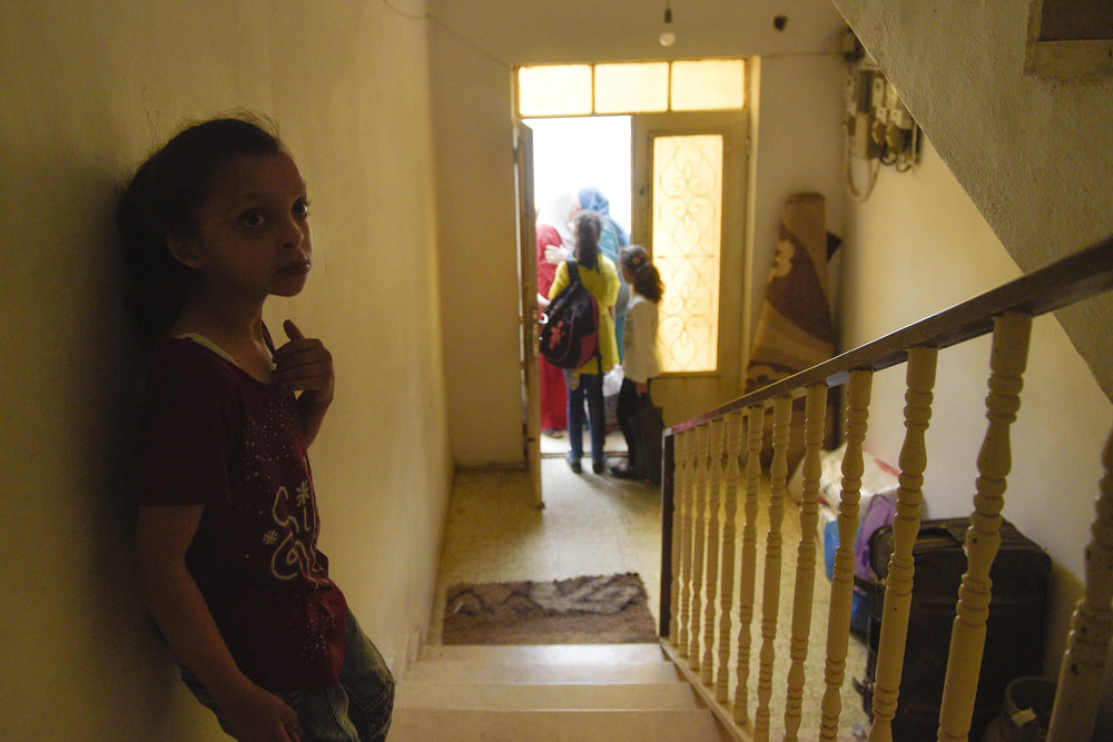 As other students parents arrive to pick them up from the boarding house Hala Kakaour stands at the top of the stairs listening and observing her classmates leaving.