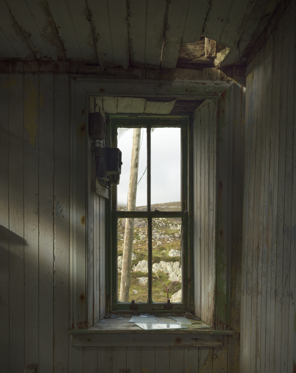 Looking through the window of a Lingara Bay deserted Croft house.