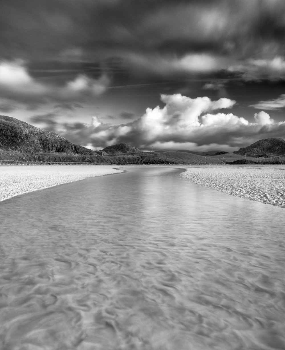 Winding water on the white sands of Uig Beach, Lewis.