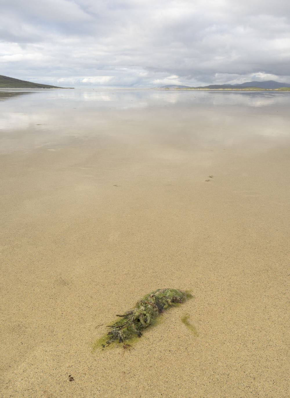Never ending horizon on Scarasta wet sands, South Harris,