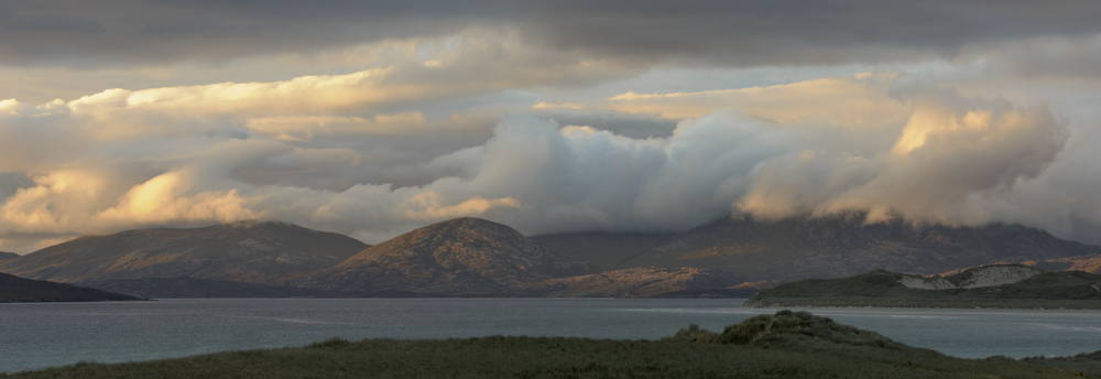 The North Harris Mountains side lit by the setting Autumn sun, Harris.