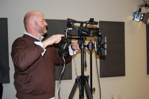 Mike Vannoy, COO of Sales Engine, adjusts the camera from a wide shot to a medium shot. -