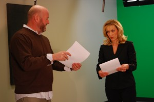 Mike Vannoy gives direction to Rachelle between script segments. Breaking your script into segments makes it easier for the talent and gives the director time to make adjustments.