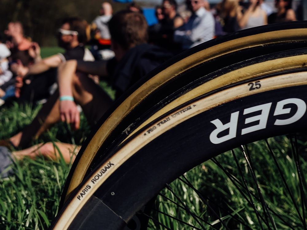 Pro support. Just lounging in the grass with the fans at the summit of The Koppenberg with some of the most coveted tyres in the world.
