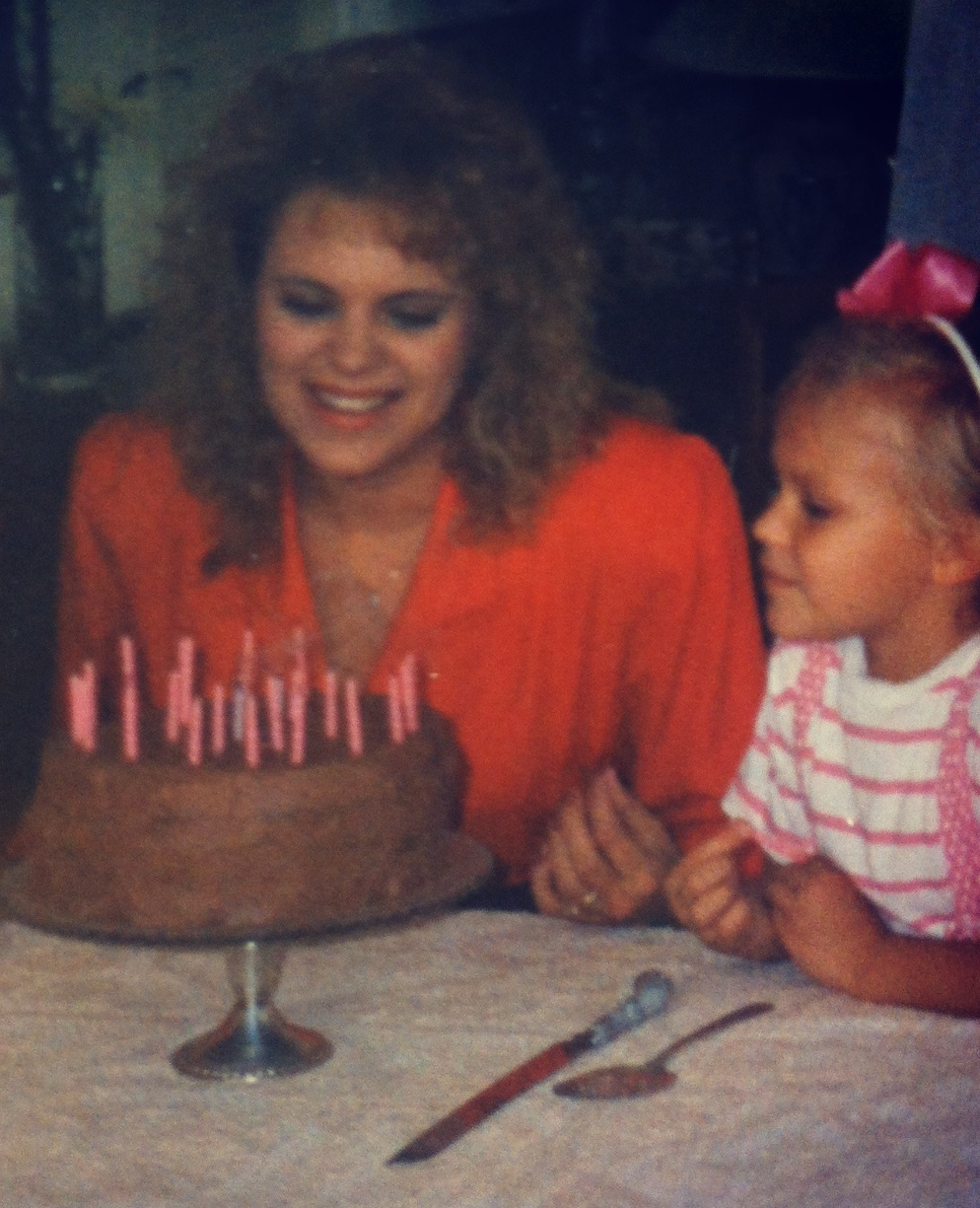 Big hair, tans and bows! Me and mom circa 1990