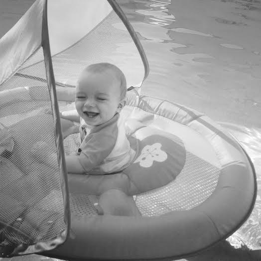 Camden loving his float canopy say in the pool!