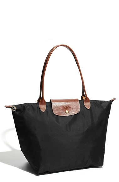 "Longchamp 'Large Le Pliage' Tote Black       $145 (on sale!) - Ladies, I give you my official ""mom bag"" LOL. I finally got so tired of lugging around my diaper bag and decided to upgrade. Granted, I loved my diaper bag but I needed something a little more lightweight and not so bulky. I love this tote. It's made with      water-resistant nylon and comes in a variety of colors, each trimmed with embossed leather     . It literally hold everything from my own personal items to bottles, sippy cups, diapers etc. Much easier to tote with a toddler in tow. Pun intended ;)"