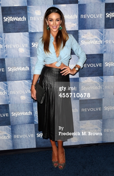 The gorgeous Courtney Bingham Sixx in denim and a midi leather skirt! Love this!