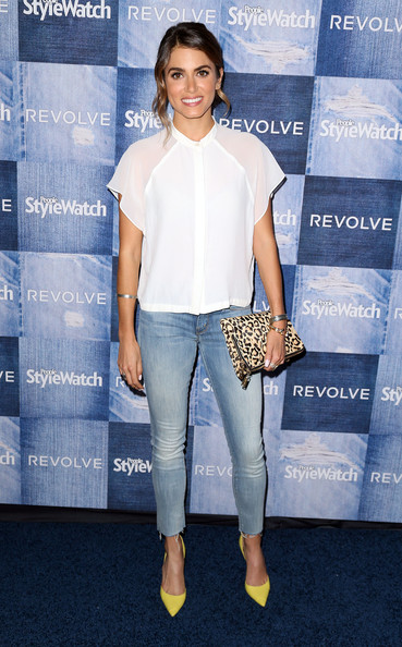 The super sweet and hilarious Nikki Reed looking effortless with her pop of color in her heels and leopard clutch.