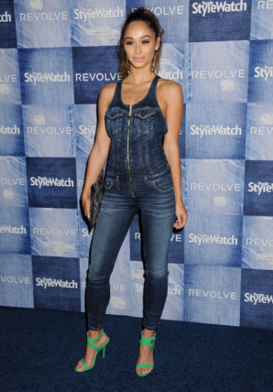 Cara Santana looking fierce in a denim jumpsuit with green pumps.