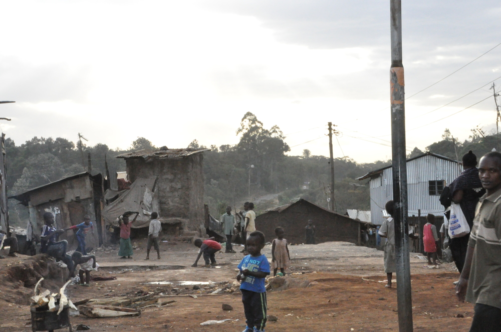 boy at gates of Kibera.JPG
