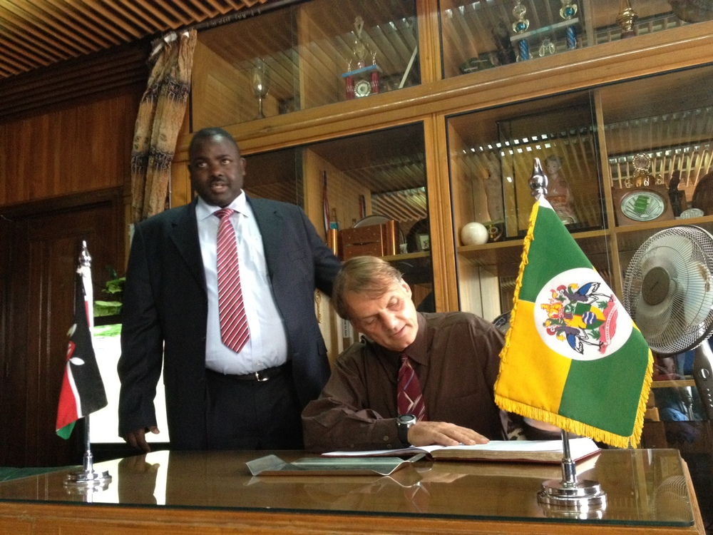 David signs the mayor's book.JPG