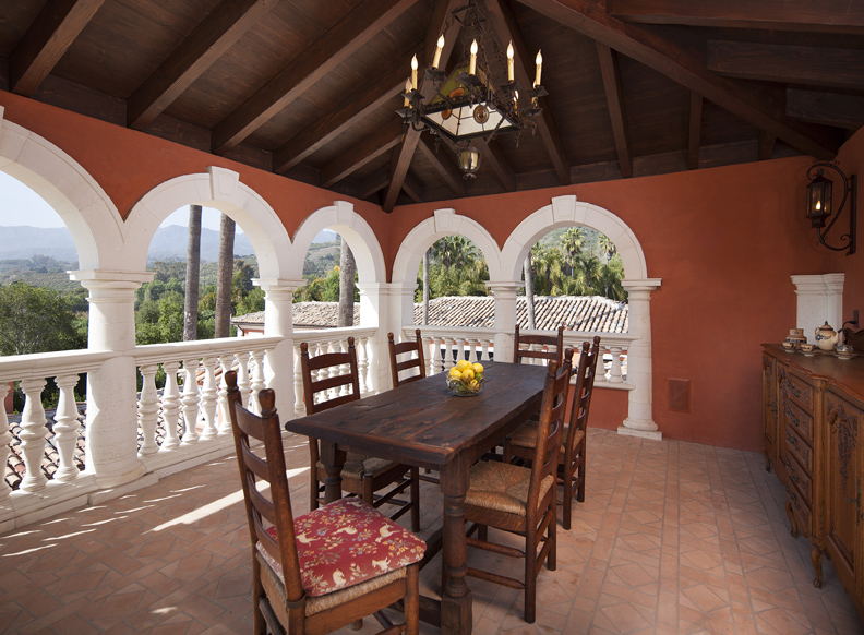 This estate's tower hosts a majestic, hidden dining room with views out over the ocean, valley and surrounding mountains