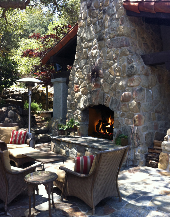 An outdoor fireplaces at Deer Lodge.