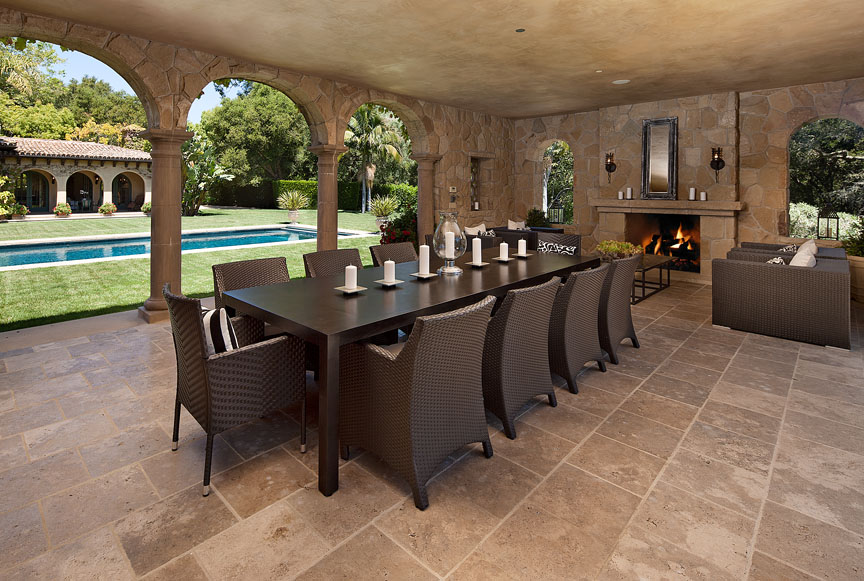 This romantic outdoor dining space is complemented by an outdoor kitchen.