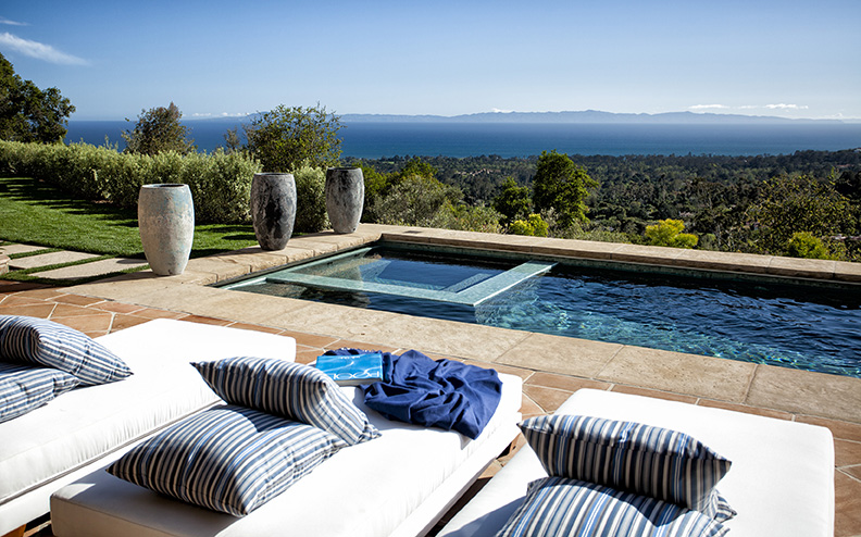Expansive ocean views, a pool with lavish pool house and approximately 8,000sf of living space command a $13,695,000 price tag for this Montecito estate.