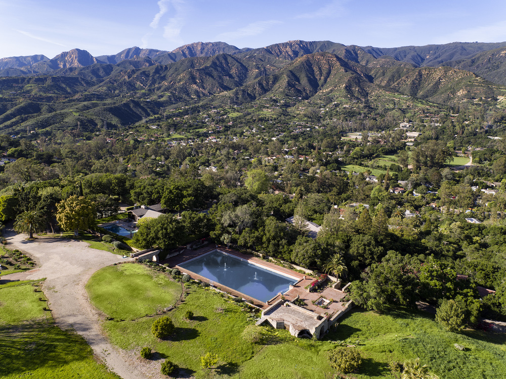 Land and home for sale in Montecito Santa Barbara California ocean views mountain views historic estate 605 607 Cowles hilltop baron dream home Riskin Partners Village Properties tennis court pool pond