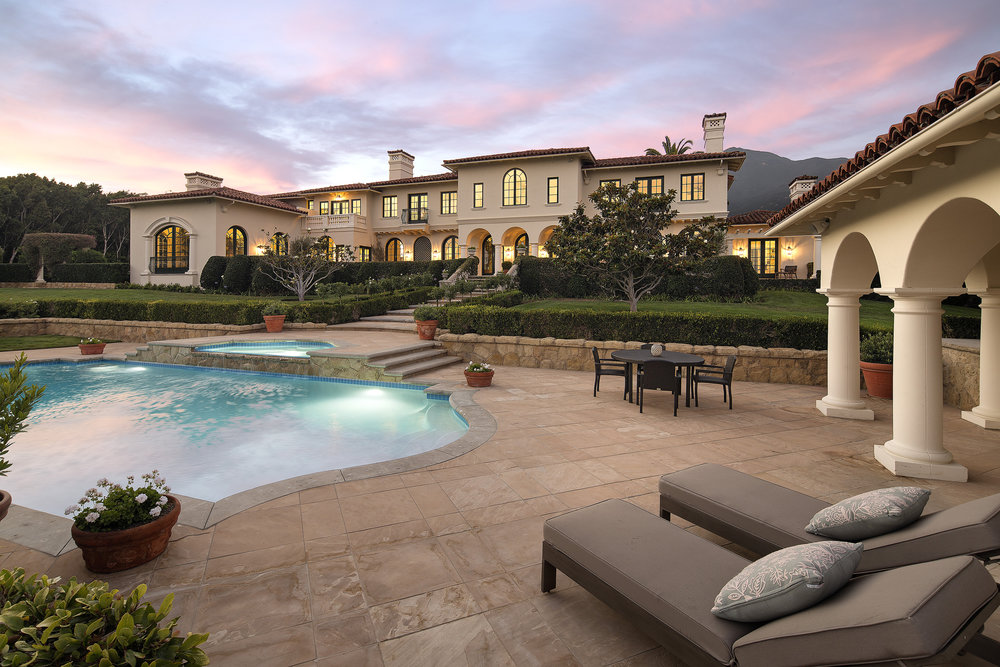 Luxury estate home for sale in Montecito Santa Barbara California private family home remodeled ocean views mountain views gated estate pool tennis court celebrity estate Riskin Partners Rebecca Riskin Village Properties 710 Picacho Lane CA 93108
