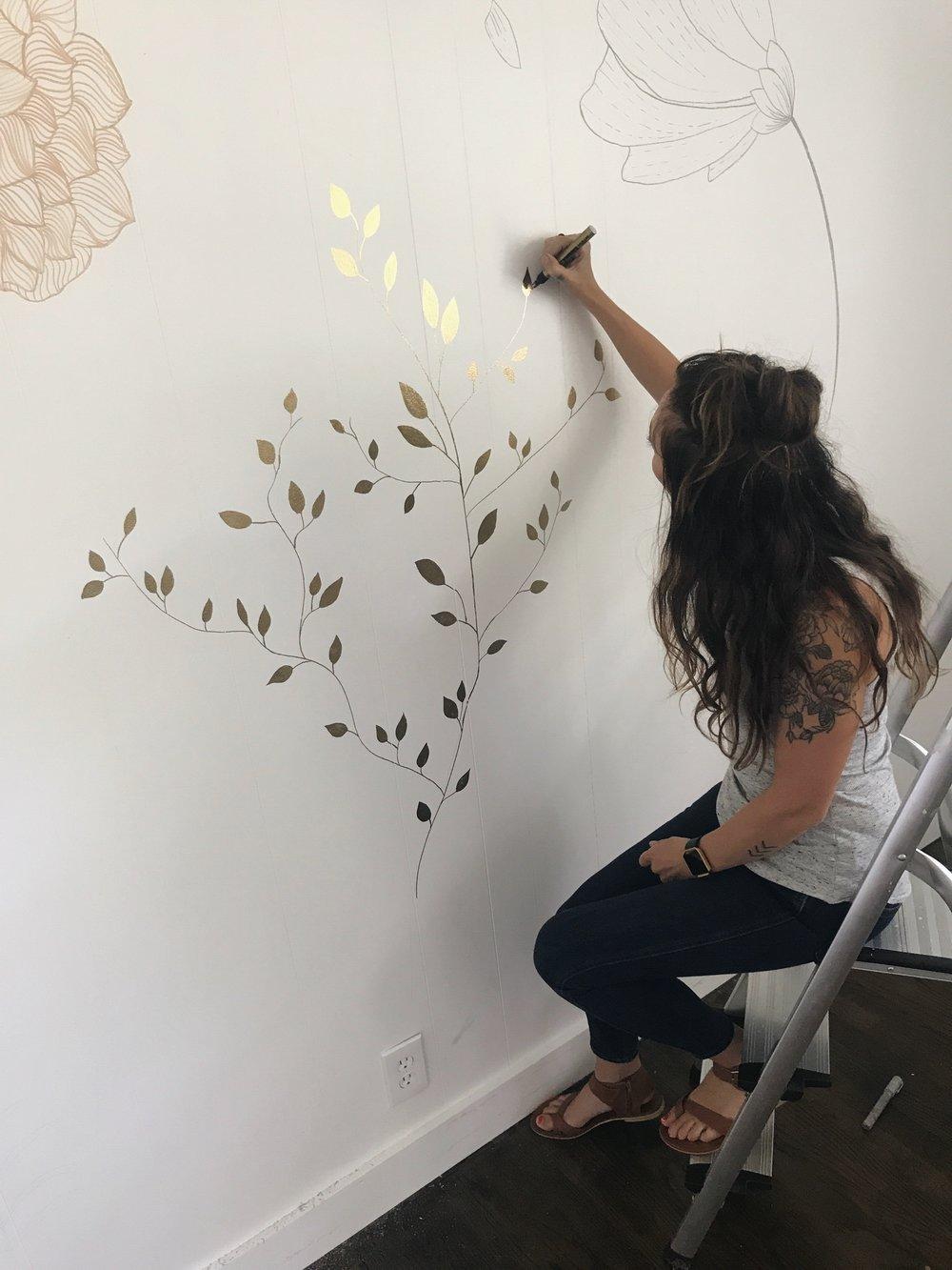 Twila Mural Sitting on ladder.jpg