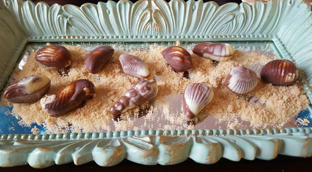 Chocolate truffle sea shells + sea horses on a bed of sweet brown sugar. What's not to love?