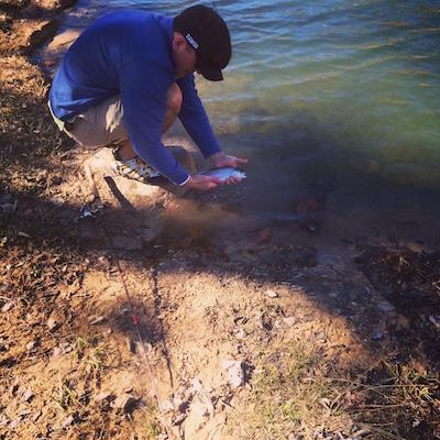 John releasing a trophy trout.