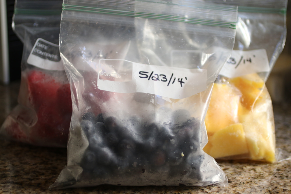 I pulled some of my already frozen blueberries, strawberries, and mango out of the freezer to show the final product. Makes me hungry for a smoothie!