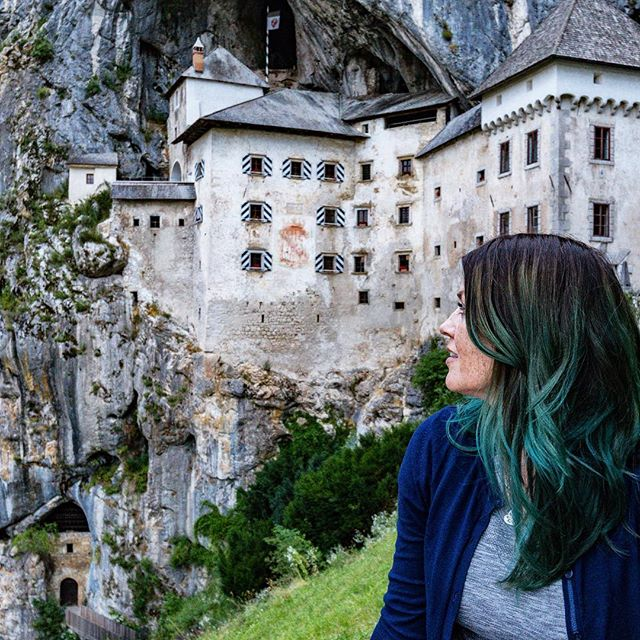 "🎵There is a castle in a cave🎶 . As an American, big stone castles are always fun to visit. We don't have many medieval monuments in our world. . But a castle in a CAVE? Bring it on. . This beauty is in Predjama, Slovenia and it's worth a stop. In truth, I was so behind in getting to the town of Postojna where you buy your tour tickets (hello 6 course lunch), that I missed the window to tour the interior. . But pro tip? If you go in the long hours of early sunset you get the entire place to yourself. My friend @rachelleahcohen and I went around 7pm and found the solitude irresistible. What went from a ""let's just spend 10mins"" turned into an hour-long photo shoot of silliness and awe. . Slovenia was one of my big surprise countries this year. I enjoyed it so very much and every day was some new fantastic discovery. If you can swing a visit you won't be disappointed. I also wrote out my entire 5-day, 3-town itinerary of where to eat, where to stay, what to do over on the blog (CleverDeverWherever.com) if you need help planning. . Do you visit castles on your trips? Have any favorites? . . . . . 📷 @rachelleahcohen #slovenia #feelslovenia #igslovenia #slovenija #ifeelslovenia #visitslovenia #postojna #discover_europe_ #slovenianexplorer #julianadever #cleverdever #travel  #whereiwork #planetdiscovery #welivetoexplore #exploremore #roamtheplanet #travelon #predjamacastle #predjama #castle #lifeofadventure #traveldiary #travelwithme #wearetravelgirls #femmetravel #shetravels"