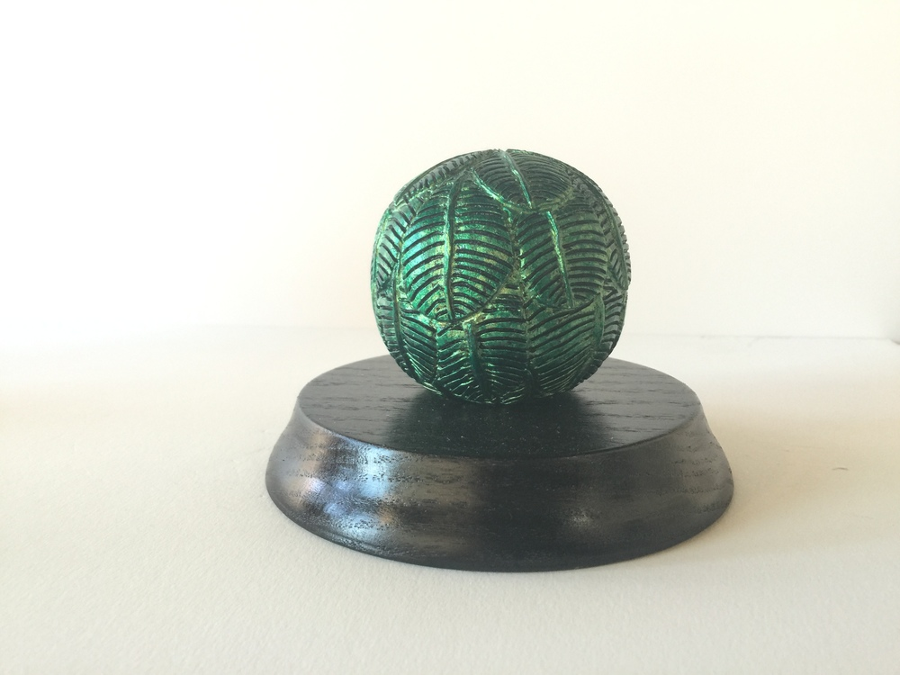 "Cherry Hollowed Ball Carved Leaves Metallic Green on Red Oak Base 5"" wide x 4"" high      Price - $325"