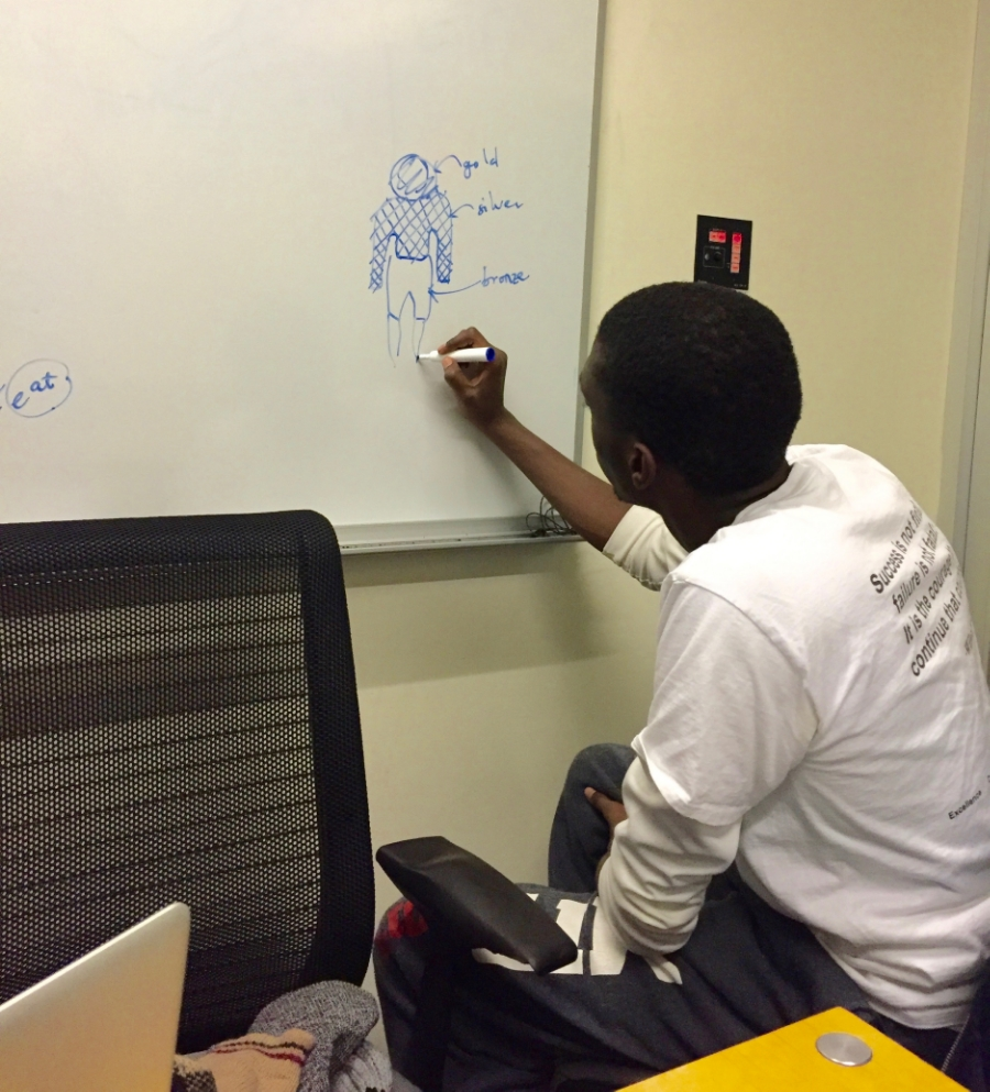 Kwabena drawing the statue in the vision of Daniel 2 during a study session.
