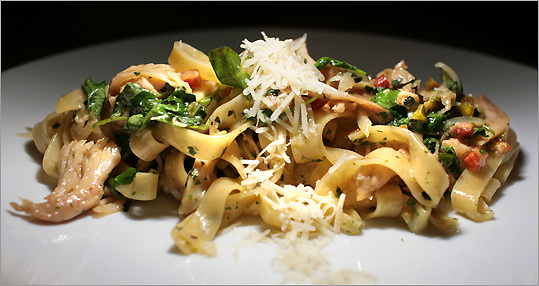 House-made tagliatelle, with pieces of confit chicken and pancetta, gets an added flavor boost from preserved lemon, watercress and pistachios.Aram Boghosian for The Boston Globe