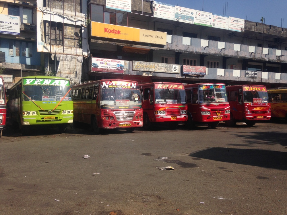 Red buses (and one green) of Kochi.