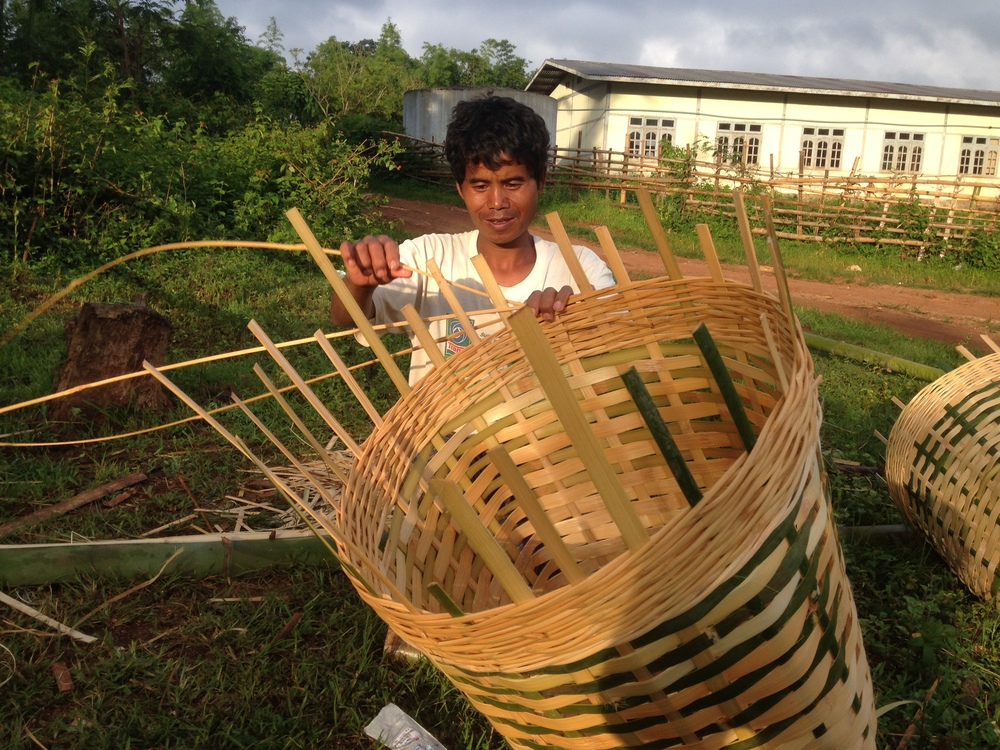 Hand weaving baskets from bamboo.