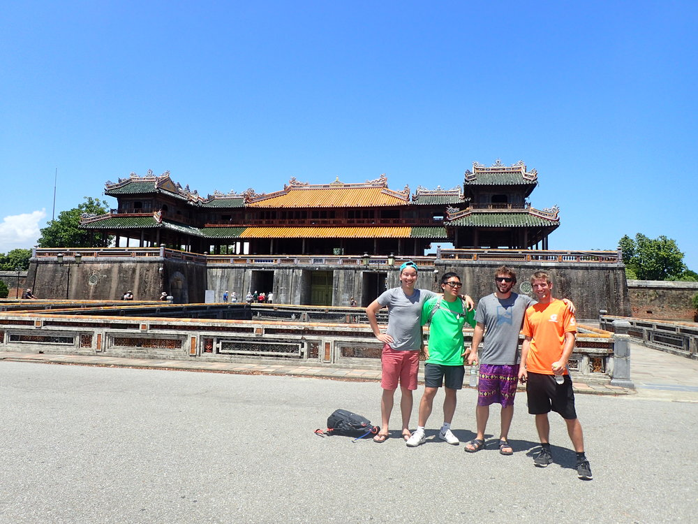 Richard, John, myself, and Andy in front of the Citadel in Hue