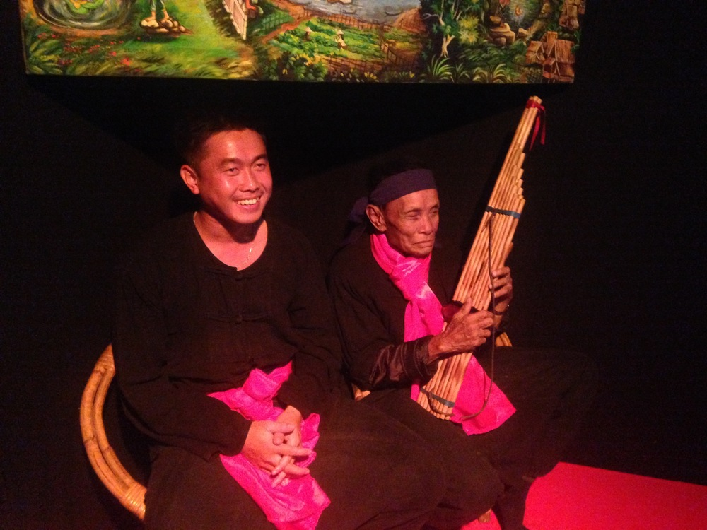 Two performers telling stories and playing traditional music in Luang Prabang