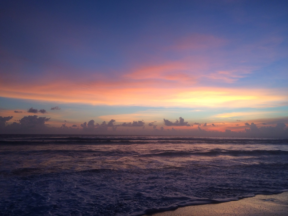 A typical beautiful sunset on the coast of Canggu, Bali