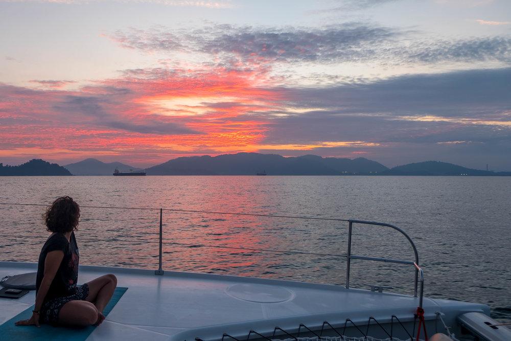 Larissa watching the sunset near Port Klang
