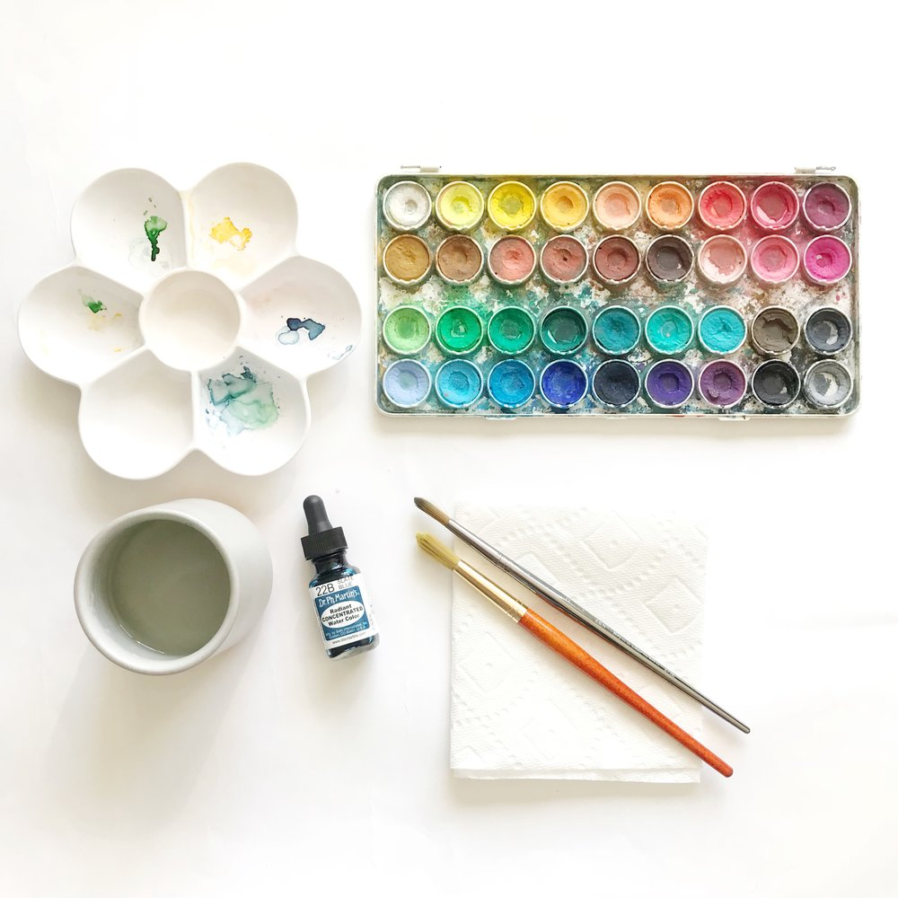 WATERCOLOR SUPPLIES USED IN THIS LESSON  Watercolor pre-mixed palette (I'm using an old Canson-Talens palette) 22B Slate Blue (Dr. Ph Martin's Brand) Size 12 Round Watercolor Brush Size 8 Round Watercolor Brush Mixing tray or porcelain dish Cup of water Napkin