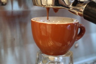 espresso pouring - brewing out of machine American Bulldog Coffee Roasters.jpg