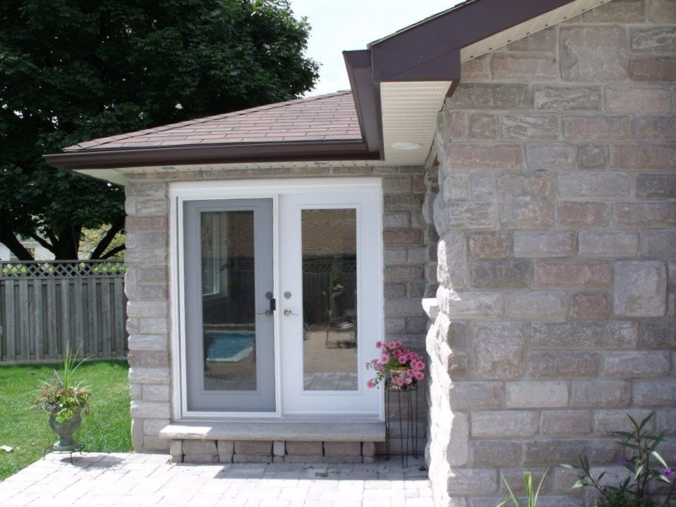 tHIS ADDITION ADDED EXTRA SPACE AND a beautiful patio door to this home.