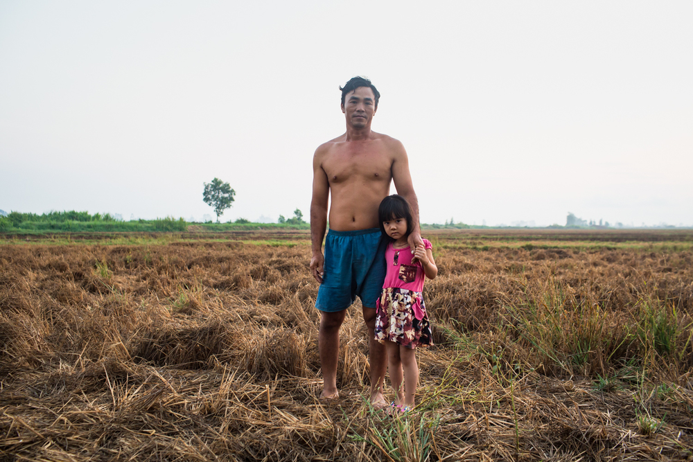 April 27, 2016.  We met Khanh and his daughter Quynh in the same field.  He told us that his cows won't even eat the spoiled rice straw as it is too salty so he has to buy hay and water for them.  He has taken temporary work temporary work as a builder in town until the rains comes and he can start work in his rice fields again.