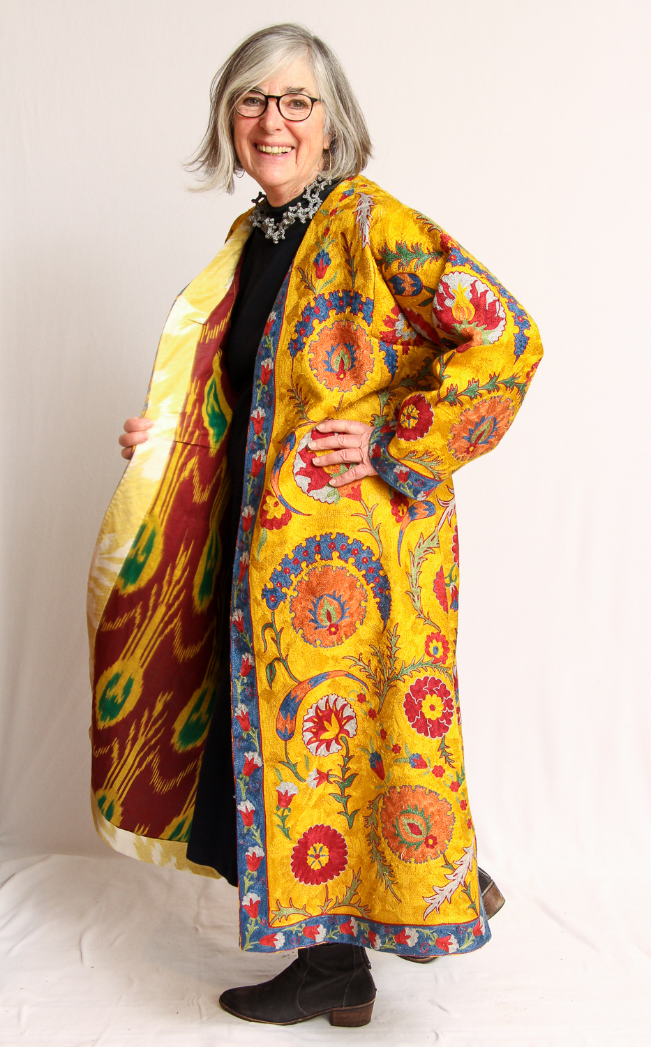 """Judith Bird - """"I fell in love with this coat when I met the man who made it in Uzbekistan. I just said, 'This is the most beautiful thing I've ever seen in my whole life.' And it's way over my pay grade to have bought it, but it didn't matter. It was just so beautiful, I couldn't not have it—which is an odd way to live. But, we all have times when things are that special. I don't take it to the grocery store.As for my personal style, I dress every day. I take care of what I put on. I think about where I'm going, what I'm doing, what looks good with what—and it's just a playground. My wardrobe is a playground. It seems like I can do something fun almost every day."""""""