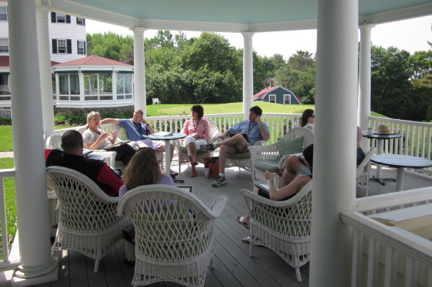 A small group session on the porch at Crow's Nest Institute.